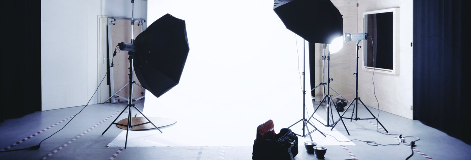 a photoshoot backdrop with lights set up