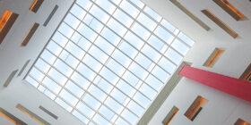 upwards shot of a skylight window in a building
