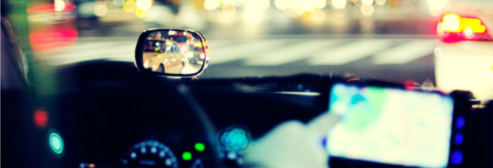 a blurred image of a car's dashboard