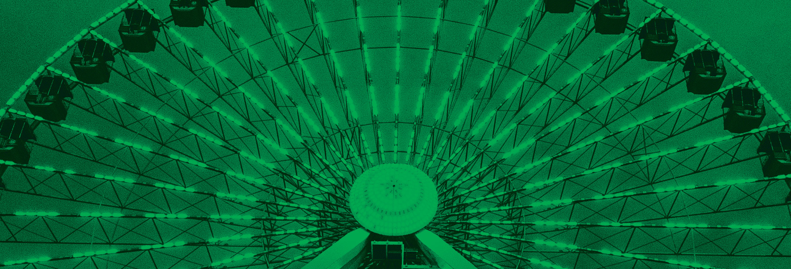a monocolored green photo of a ferris wheel