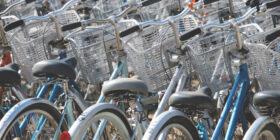 a bike rack full of bicycles