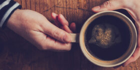 top down shot of a person holding a coffee cup