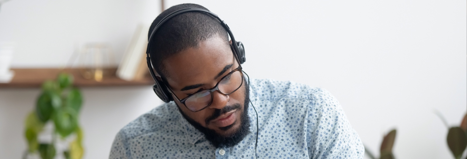 a black man with headphones listening to music