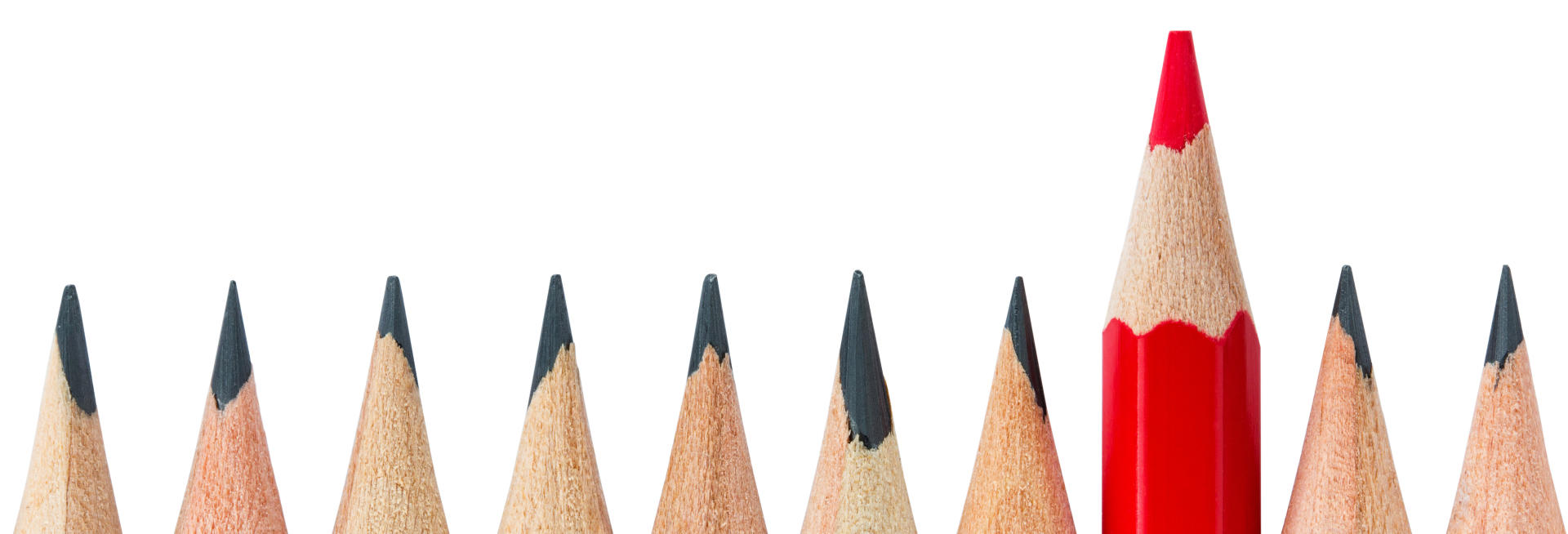 pencils aligned in a row and a red colored pencil sticking out of the row