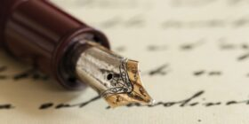 an inkwell pen sitting on a letter