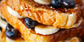 a stack of french toast, blueberries, and bananas
