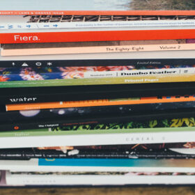 pile of magazines on a wooden table