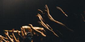 a concert crowd waving