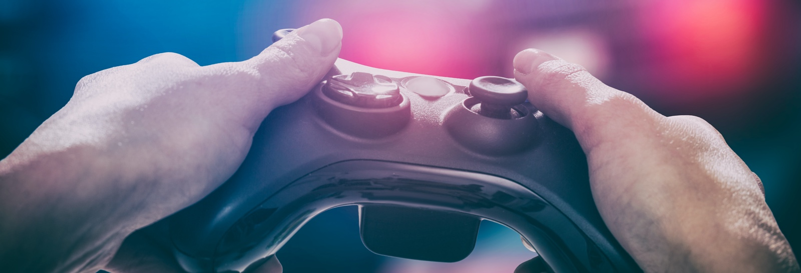 a person holding a video game controller