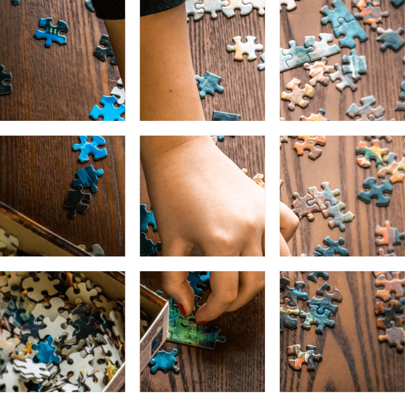 a person putting puzzles together