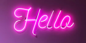 neon hello text in the evening sky