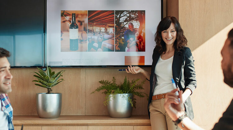 Woman in a conference room give a presentation
